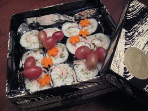 A bento box of deli meat sushi rolls for school lunch