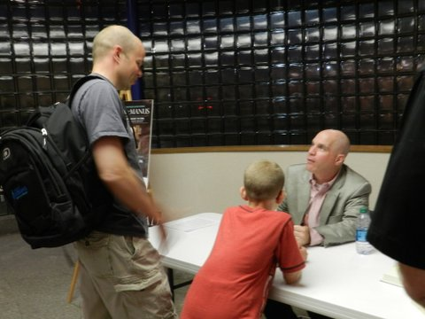 John McManus chatting with an Iraq combat veteran and his son